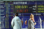 January 11, 2013, Tokyo, Japan - The 225-issue Nikkei Stock Average surges 148.93 points, or 1.4%, to end the day at 10,801.57 on Friday, January 11, 2013. The benchmark index closed above 10,800 for the first time since Feb. 21, 2011.  (Photo by Natsuki Sakai/AFLO)