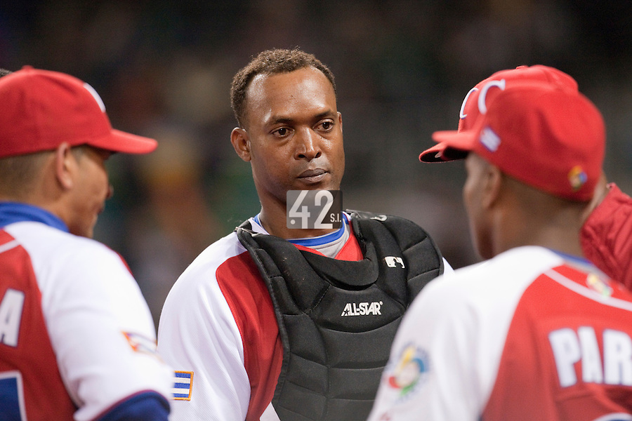 16 March 2009: #40 Rolando Merino of Cuba listens to a coach during the 2009 World Baseball Classic Pool 1 game 3 at Petco Park in San Diego, California, USA. Cuba wins 7-4 over Mexico.