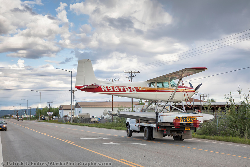 Bush plane on floats is transported through the streets of Fairbanks on a flatbed truck, Fairbanks, Alaska.