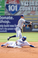 Montgomery Biscuits shortstop Jake Hager (2) turns a double play as Darnell Sweeney (9) of the Chattanooga Lookouts slides into second base at AT&T Field on July 23, 2014 in Chattanooga, Tennessee.  The Lookouts defeated the Biscuits 6-5. (Brian Westerholt/Four Seam Images)