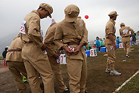 Competitors dressed in PLA (People's Liberation Army) revolutionary era outfits participate in the Red Games. Held in Junan County, this sporting event is a nostalgic tribute to the communist era.