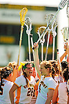 25 April 2009: University of Vermont Catamount midfielder Jessa Merrill (26), a Senior from Kennebunk, ME, and attackman Kaitlyn Fuller (4), a Junior from Jordan, NY, celebrate after a game against the Stony Brook University Seawolves at Moulton Winder Field in Burlington, Vermont. The Lady Cats defeated the visiting Seawolves 19-11 on Seniors Day, Vermont's last home game of the 2009 season. Mandatory Photo Credit: Ed Wolfstein Photo
