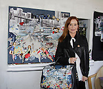 """Jacklyn Zeman """"Bobbie Spencer"""" shows off Jane Elissa's bag and behind her is artwork - General Hospital helps raise money for Leukemia and Cancer Research. (Photo by Sue Coflin/Max Photos)"""