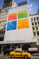 Just five blocks from the Apple Fifth Avenue store a construction shed heralds the imminent arrival of the flagship Microsoft store also on Fifth Avenue, seen on July 23, 2015. The store is scheduled to open in the Fall of 2015. (© Richard B. Levine)