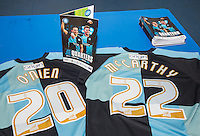 Luke O'Nien of Wycombe Wanderers & Jason McCarthy of Wycombe Wanderers shirts with programme during the Sky Bet League 2 match between Wycombe Wanderers and Mansfield Town at Adams Park, High Wycombe, England on 25 March 2016. Photo by Andy Rowland.