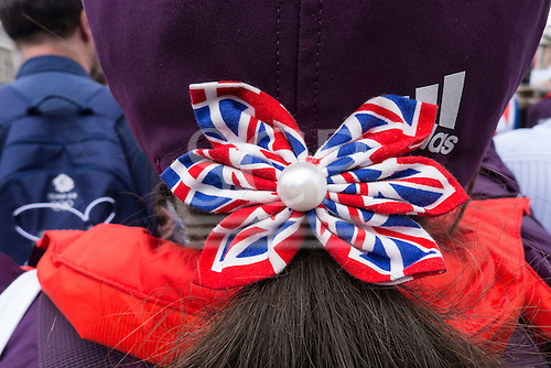 Trafalgar Square, London, Engand. A British supporter with Union Jack bow in her hair, in the crowds.