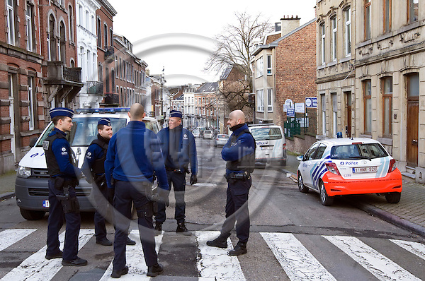 """VERVIERS - BELGIUM - 16 January 2015 -- Belgium police anti-terror raid Thursday evening in Verviers - 2 suspects killed one arrested. -- Police have blocked and guard the street """"rue de la Colline"""" where the shoot-out with the suspect happened. -- PHOTO: Juha ROININEN / EUP-IMAGES"""