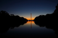 View of Washington Monument and Reflecting Pool at Sunrise.