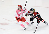 Marie-Philip Poulin (BU - 29), Casey Pickett (Northeastern - 14) - The Boston University Terriers defeated the visiting Northeastern University Huskies 3-2 on Saturday, January 28, 2012, at Agganis Arena in Boston, Massachusetts.