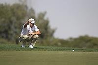 Tom Lewis (ENG) lines up his putt on the 12th green during Friday's Round 3 of the Commercial Bank Qatar Masters 2013 at Doha Golf Club, Doha, Qatar 25th January 2013 .Photo Eoin Clarke/www.golffile.ie
