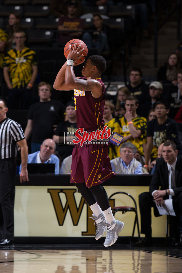 Nate Mason (2) of the Minnesota Golden Gophers fires up a jump shot during second half action against the Wake Forest Demon Deacons at the LJVM Coliseum on December 2, 2014 in Winston-Salem, North Carolina.  The Golden Gophers defeated the Demon Deacons 84-69. (Brian Westerholt/Sports On Film)