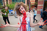 27 MAY 2011 - PHOENIX, AZ: MICHELLE GREEN, from Mesa, AZ, participates in the Zombie Walk at Phoenix Comicon Friday. Phoenix Comicon opened Thursday and featured a Zombie Walk through downtown Phoenix Friday night. Hundreds of people participated in the Zombie Walk, both as Zombies and as Zombie hunters. This year's Comicon includes appearances by Leonard Nimoy (Star Trek), Adam Baldwin (Firefly and Chuck), Stan Lee (Marvel Comics), Nicholas Brendon (Buffy the Vampire Slayer) and others. Activities include costuming workshops, role playing games and a Geek Prom.     Photo by Jack Kurtz