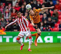 7th March 2020; Bet365 Stadium, Stoke, Staffordshire, England; English Championship Football, Stoke City versus Hull City; Callum Elder of Hull City heads the ball in front of Tom Ince of Stoke City