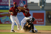 May 31 2009: Chris Jackson and Gabriel Suarez of the Lancaster JetHawks vie for the ball as Charlie Blackmon of the Modesto Nuts attempts a steal of second base at Clear Channel Stadium in Lancaster,CA.  Photo by Larry Goren/Four Seam Images