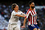 Luka Modric of Real Madrid and Antonio Adan of Atletico de Madrid