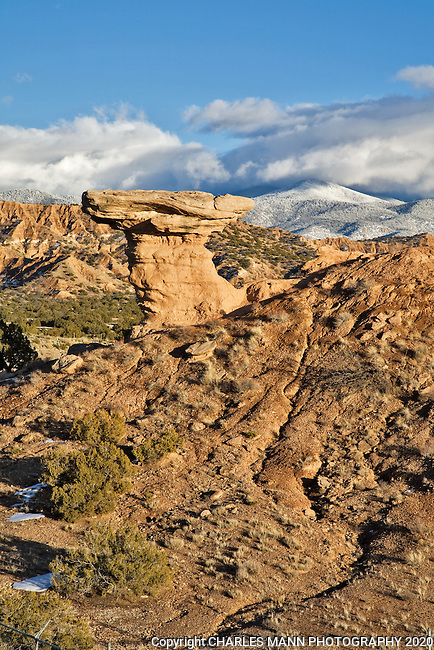 A winter scene featuring Camel Rock, an unusual earth formation which has become a landmark in the small pueblo village of Tesuque, just a few miles north of Santa Fe