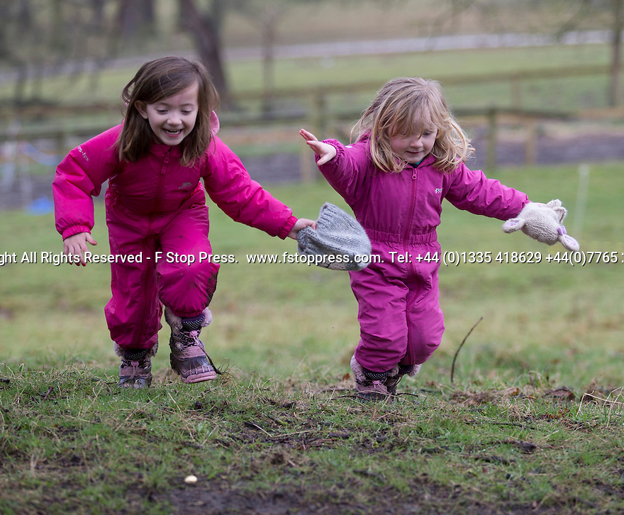 03/04/15<br /> <br /> ***PHOTO ORDER - F.A.O. MATT FEARN***<br /> <br /> L/R: Sisters, Matilda (5) and Lucy (2) Johnson.<br /> <br /> Children brave the rain to take part in a Good Friday  Easter Egg hunt at Chatsworth House in the Derbyshire Peak District.<br /> <br /> All Rights Reserved - F Stop Press.  www.fstoppress.com. Tel: +44 (0)1335 418629 +44(0)7765 242650