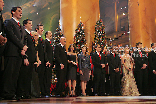 Washington, DC - December 14, 2008 -- First lady Laura Bush joins Dr. Phil McGraw and his wife Robin, center-left, along with stage performers Sunday, December 14, 2008, during the annual Christmas in Washington performance at the National Building Museum in Washington D.C. .Credit: Joyce N. Boghosian - White House via CNP