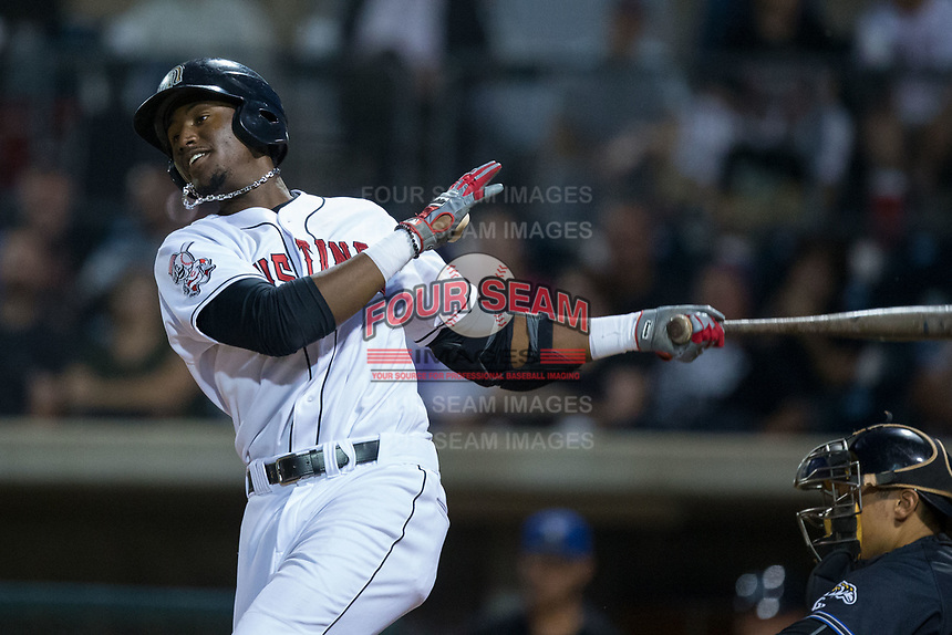 Montrell Marshall (29) of the Billings Mustangs follows through on his swing against the Missoula Osprey at Dehler Park on August 21, 2017 in Billings, Montana.  The Osprey defeated the Mustangs 10-4.  (Brian Westerholt/Four Seam Images)