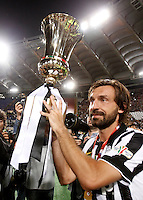 Calcio, finale Tim Cup: Juventus vs Lazio. Roma, stadio Olimpico, 20 maggio 2015.<br /> Juventus' Andrea Pirlo holds the trophy at the end of the Italian Cup final football match between Juventus and Lazio at Rome's Olympic stadium, 20 May 2015. Juventus won 2-1 after extra time.<br /> UPDATE IMAGES PRESS/Isabella Bonotto