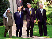 From left to right: Chairman Yassir Arafat of the Palestinian Authority, King Hussein of the Hashemite Kingdom of Jordan, United States President Bill Clinton, and Prime Minister Benyamin Netanyahu of Israel leave the Oval Office at The White House in Washington, DC after their talks on October 1, 1996.<br /> Credit: Ron Sachs / CNP