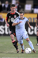 Sporting Kansas City midfielder Graham Zusi (8) shields the ball from D.C. United midfeilder Perry Kitchen (23) Sporting Kansas City defeated D.C. United  1-0 at RFK Stadium, Saturday March 10, 2012.