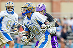Los Angeles, CA 02/15/14 - Nolan Werner (UCLA #28) and Garrett Remsen (Washington #15) in action during the Washington versus UCLA  game as part of the 2014 Pac-12 Shootout at UCLA.  UCLA defeated Washington 13-7.