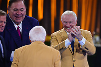 Canton, Ohio - August 2, 2019:  Gil Brandt is congratulated by NFL Commissioner Roger Goodell, Hall of Fame President David Baker and Dallas Cowboys owner Jerry Jones after receiving his Hall of Fame Gold Jacket at the Canton Civic Center in Canton, Ohio August 2, 2019.  (Photo by Don Baxter/Media Images International)