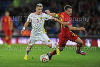 Cardiff City Stadium, Friday 11th Oct 2013. Aaron Ramsey of Wales battles with Ezgjan Alioski of Macedonia during the Wales v Macedonia FIFA World Cup 2014 Qualifier match at Cardiff City Stadium, Cardiff, Friday 11th Oct 2014. All images are the copyright of Jeff Thomas Photography-07837 386244-www.jaypics.photoshelter.com