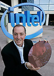 Intel Corp. CEO Paul Otellini holds up a 12-inch Penryn wafer with hundreds of individual silicon chips at Intel headquarters in Santa Clara, Calif., Wednesday, Nov. 7, 2007. Leading semiconductor maker Intel Corp. reports earnings for the first quarter after the closing bell Tuesday. (AP Photo/Paul Sakuma)