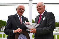 Connections of Sans Souchi collect their trophy during Afternoon Racing at Salisbury Racecourse on 18th May 2017