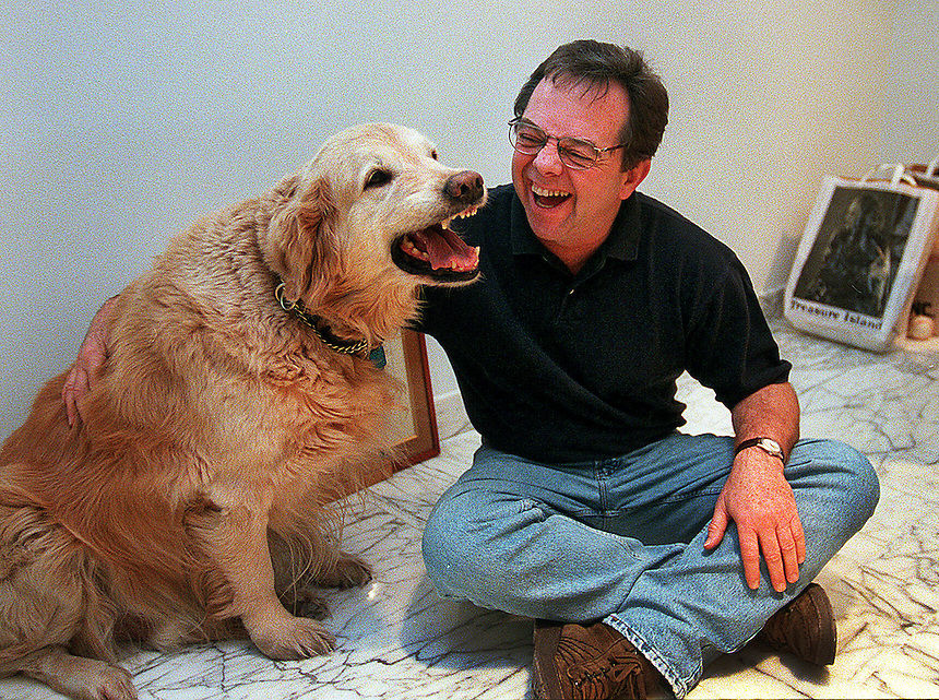 Buddy, 11, has a good laugh with his owner, Lou Conte, founder and head of Hubbard St.