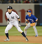(L-R) Ichiro Suzuki (Yankees), Munenori Kawasaki (Blue Jays),.APRIL 26, 2013 - MLB :.Ichiro Suzuki of the New York Yankees leads off of second base as shortstop Munenori Kawasaki of the Toronto Blue is seen in the background during the baseball game at Yankee Stadium in The Bronx, New York, United States. (Photo by AFLO)