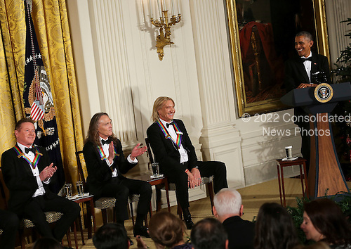 United States President Barack Obamajokes with 3 band members of the group Eagles who are 2016 Kennedy Center Honorees, in the East Room of the White House, December 4, 2016, Washington, DC. Eagles band members are.  The 2016 honorees are: Argentine pianist Martha Argerich; rock band the Eagles; screen and stage actor Al Pacino; gospel and blues singer Mavis Staples; and musician James Taylor.<br /> Credit: Aude Guerrucci / Pool via CNP