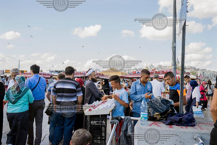 A pavement cigarette vendor sells cheap cigarettes in Eminonu.