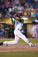 Miles Gordon (10) of the Dayton Dragons follows through on his swing against the Bowling Green Hot Rods at Fifth Third Field on June 8, 2018 in Dayton, Ohio. The Hot Rods defeated the Dragons 11-4.  (Brian Westerholt/Four Seam Images)