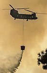 August 21, 2001 Coulterville, California  -- Creek Fire – Military type helicopter drops water on Cuneo Road hot spots.  The Creek Fire burned 11,500 acres between Highway 49 and Priest-Coulterville Road a few miles north of Coulterville, California.