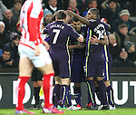 Sergio Aguero of Manchester City is mobbed after scoring the opening goal - Barclays Premier League - Stoke City vs Manchester City - Britannia Stadium - Stoke on Trent - England - 11th February 2015 - Picture Simon Bellis/Sportimage