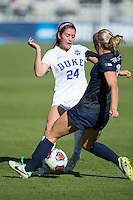 Cary, North Carolina - Sunday December 6, 2015: Frannie Crouse (9) of the Penn State Nittany Lions steals the ball from Morgan Reid (24) of the Duke Blue Devils during first half action at the 2015 NCAA Women's College Cup at WakeMed Soccer Park.  The Nittany Lions defeated the Blue Devils 1-0.
