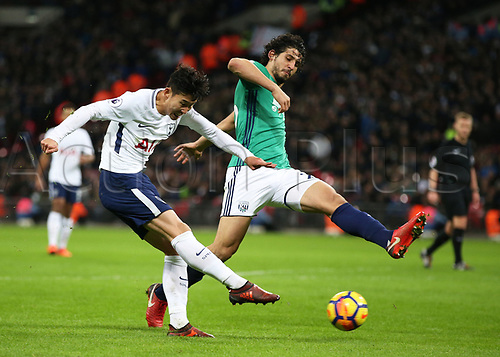 25th November 2017, Wembley Stadium, London England; EPL Premier League football, Tottenham Hotspur versus West Bromwich Albion; Son Heung-Min of Tottenham Hotspur crossing the ball with Ahmed Hegazy of West Bromwich Albion attempting to block the cross