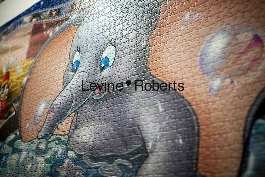 """Detail of Ravensburger's """"Memorable Disney Moments"""" world record setting jigsaw puzzle at the 114th North American International Toy Fair in the Jacob Javits Convention center in New York on Sunday, February 19, 2017.  The four day trade show with over 1000 exhibitors connects buyers and sellers and draws tens of thousands of attendees.  The toy industry generates over $26 billion in the U.S. alone and Toy Fair is the largest toy trade show in the Western Hemisphere. (© Richard B. Levine)"""