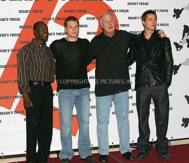 WWW.ACEPIXS.COM . . . . .  ... . . . . US SALES ONLY . . . . .....BERLIN, DECEMBER 15, 2004....Don Cheadle, Matt Damon, Jerry Weintraub and Brad Pitt  at the German premiere of Ocean's Twelve.....Please byline: FAMOUS-ACE PICTURES-G. SCHOBER... . . . .  ....Ace Pictures, Inc:  ..Alecsey Boldeskul (646) 267-6913 ..Philip Vaughan (646) 769-0430..e-mail: info@acepixs.com..web: http://www.acepixs.com