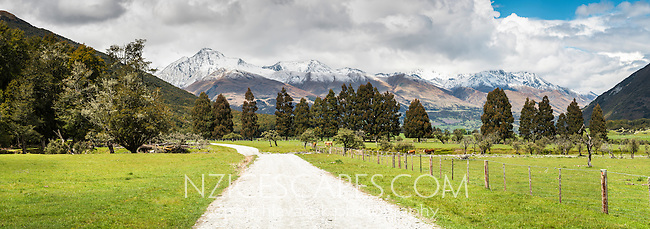 Gravel road through famland in Paradise near Glenorchy, Mt. Aspiring National Park, Central Otago, New Zealand