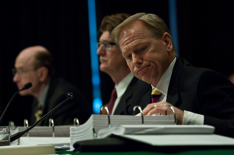 WASHINGTON, DC - April 13: James Vanasek, former chief risk officer at Washington Mutual Bank in Scottsdale, Ariz., Ronald Cathcart, former chief risk officer at Washington Mutual Bank in Seattle, and Randy Melby, reading from a notebook of exhibit documents, former general auditor at Washington Mutual Bank in Miami, during the Senate Homeland Security and Governmental Affairs Subcommittee on Permanent Investigations hearing on Wall Street and the financial crisis. (Photo by Scott J. Ferrell/Congressional Quarterly)