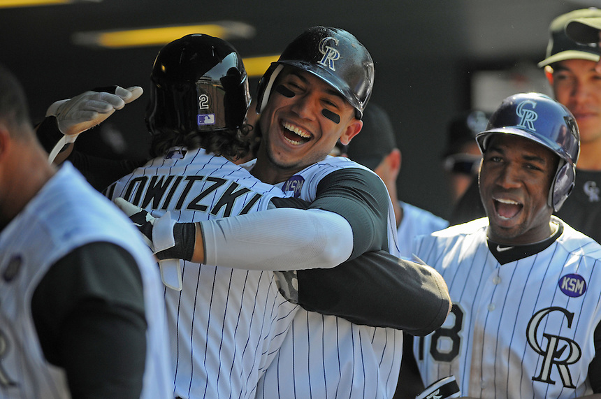 15 SEPTEMBER 2010: Colorado Rockies shortstop Troy Tulowitzki (2) and outfielder Carlos Gonzalez celebrate Tulowitzki's 2nd 3-run homerun of the afternoon during a regular season Major League Baseball game between the Colorado Rockies and the San Diego Padres at Coors Field in Denver, Colorado.   *****For Editorial Use Only*****