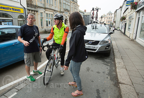 27 SEP 2013 - LISKEARD, GBR - Paul Parrish (centre) stops to talk with his support crew, Dave Dawson (left) and Alli Harmer (right) in the centre of Liskeard, Cornwall, Great Britain during the Enduroman 2013 Lands End to London to Dover ultra triathlon (PHOTO COPYRIGHT © 2013 NIGEL FARROW, ALL RIGHTS RESERVED)