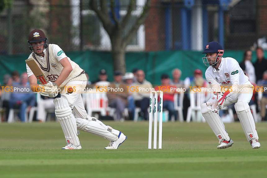 Dominic Sibley in batting action for Surrey as James Foster looks on from behind the stumps during Surrey CCC vs Essex CCC, Specsavers County Championship Division 1 Cricket at Guildford CC, The Sports Ground on 9th June 2017