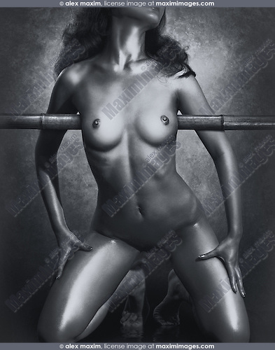 Erotic photo of a beautiful naked asian woman about to be tied up to bamboo. Black and white.