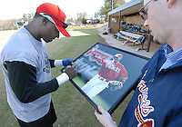 Spartanburg Methodist College grads Orlando Hudson, a Major League All-Star and Gold Glove winner, signs a photo of himself that hangs in the college before practice with the SMC baseball team Jan. 19, 2010. Hudson was later signed by the Minnesota Twins on Feb. 4. Photo by: Tom Priddy/Four Seam Images