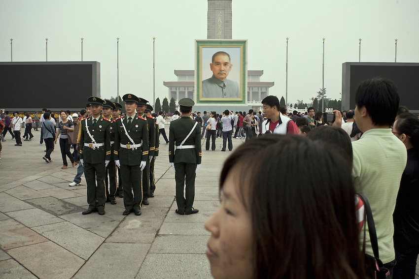 On Tiananmen square, guards near the portrait of Sun Yatsen the founder of the Chinese Republic in 1912. The anniversary of the People's Republic of China founded by Mao Zedong in 1949 will be celebrated the 1st october.<br /> In the background the Mao's mausoleum. September 27 2009.